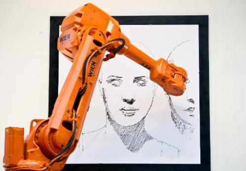 An industrial robot reproduces the art work of Austrian artist Alex Kiessling live in Breitscheidplatz in Berlin and at Trafalga