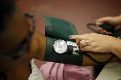 A nurse checks a patient's blood pressure on July 10, 2012 in Los Angeles, California