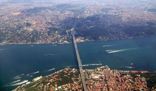 A photo of the Bosphorus river and Istanbul's Asian and European shores taken from the window of a commercial plane flying over