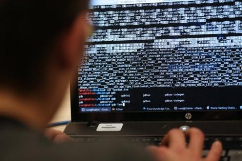 A programmer attends a hacking challenge in Meudon, west of Paris, on March 16, 2013