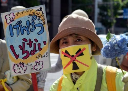 A protester holds a placard at an anti-nuclear rally in Tokyo on June 2, 2013