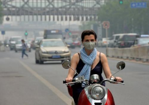 A resident wears a mask as air pollution shrouds Beijing on May 6, 2013