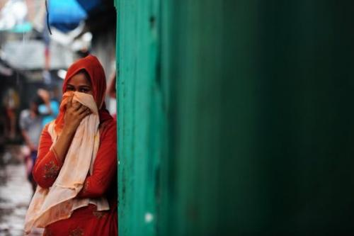 A sex worker stands outside a brothel in Madaripur, Bangladesh on July 14, 2012