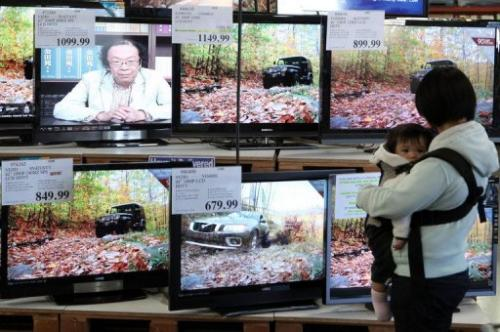 A shopper looks at a display of LCD HDTV televisions on November 18, 2009 in San Francisco, California