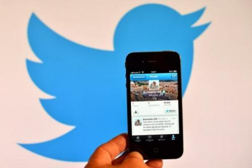 A smartphone shows the first twitter message of Pope Benedict XVI, in Rome on December 12, 2012