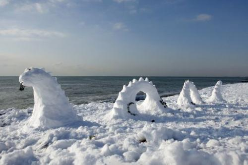 A snow sculpture of the Loch Ness monster on Brighton beach in England on December 18, 2009