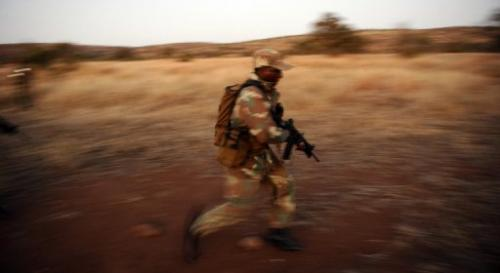 A soldier participates in a night patrol exercice against rhino poachers on July 19, 2011