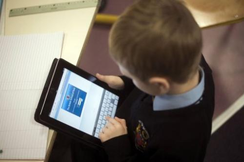 A student uses an iPad digital tablet at school on December 3, 2012 in Croissy-sur-Seine, east of Paris