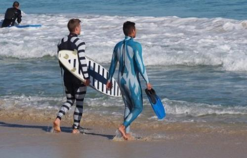 A surfer and diver wear Shark Attack Mitigation Systems (SAMS) wetsuits on July 18, 2013