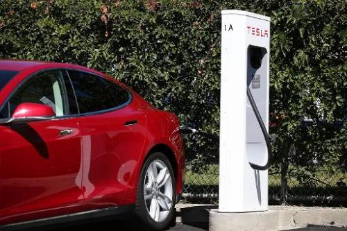 A Tesla model S sedan is plugged into a Supercharger outside the company's factory in Fremont, California on August 16, 2013