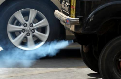 A vehicle emits exhaust fumes on a road in Bangalore on December 3, 2009