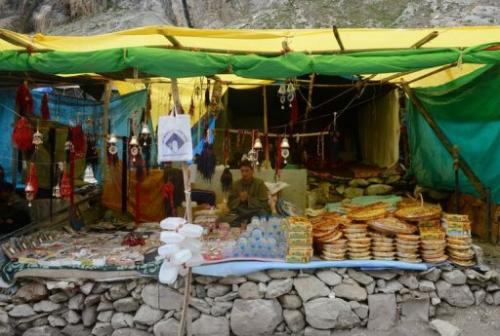 A vendor displays goods for sale at a temporary structure along the track to the Amarnath cave on August 18, 2013