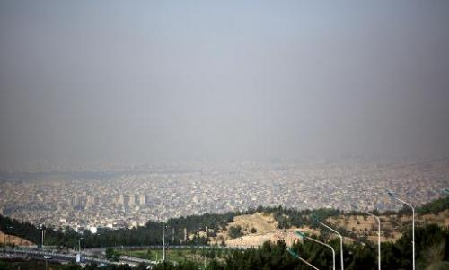 A view of Tehran taken from a vantage point in the east of Tehran shows the metropolitan capital covered in smog on June 26, 201
