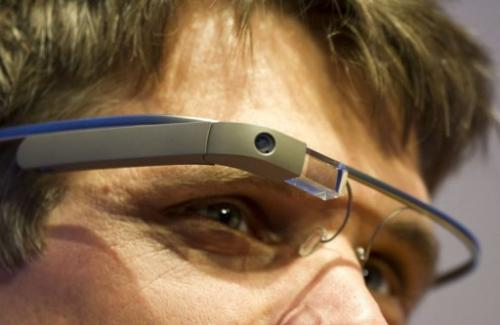 "A visitor at the ""NEXT Berlin"" conference tries out the Google Glass on April 24, 2013"