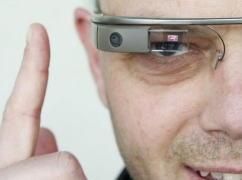 "A visitor to the ""NEXT Berlin"" conference tries out Google Glass on April 24, 2013 in Berlin"