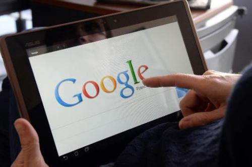 A woman searches the web using Google on May 13, 2013 in Rennes