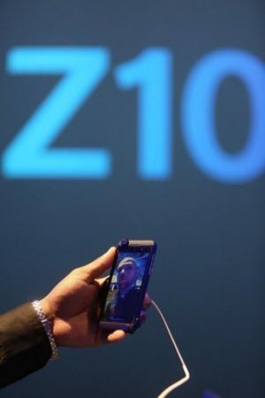 A worker demonstrates the Blackberry Z10 video feature at Pier 36 in Manhattan in New York City, on January 30, 2013