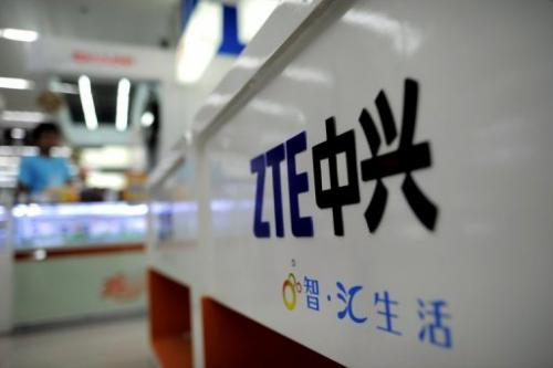 A ZTE logo is diplayed on a sales counter in Wuhan, central China's Hubei province on October 8, 2012