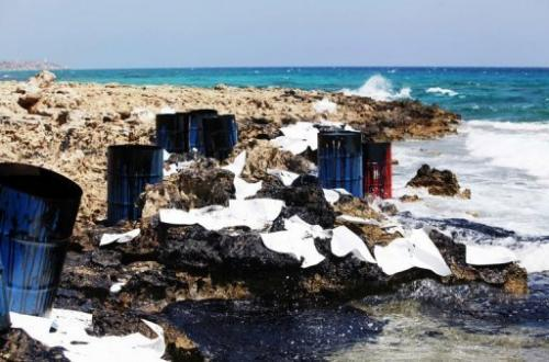 Barrels stained with oil after a spill off the coast of the Karpas peninsula in Turkish-occupied Cyprus on July 17, 2013