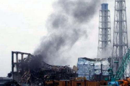 Black smoke rises from reactor number three at the Fukushima nuclear power plant in Okuma town, March 21, 2011
