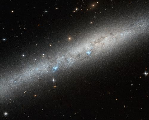 Blue bursts of hot young stars captured by Hubble