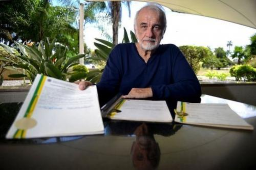 Brazilian inventor Nelio Jose Nicolai displays the patent register after an interview in Brasilia, on February 14, 2013
