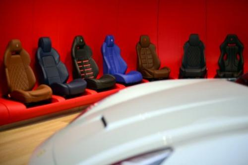 Car seats are displayed in the 'tailor-made' department on December 5, 2012 in Italy