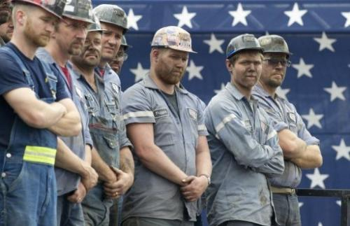Coal miners listen to Republican candidate Mitt Romney at a campaign event in Beallsville, Ohio, August 14, 2012