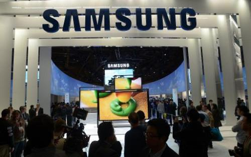 Consumers check products at Samsung booth at the 2013 International CES at the Las Vegas Convention Center on January 10, 2013