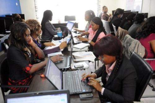 Customer care emloyees of the Nigerian job-finder site Jobberman work on June 17, 2013 in the Lagos suburb of Lekki