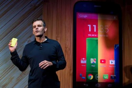 Dennis Woodside, CEO of Motorola Mobility, speaks while introducing the company's new low cost smartphone Moto G, in Sao Paulo,
