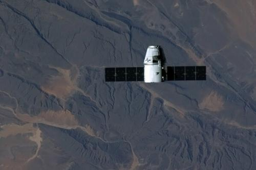 Dragon grappled and berthed at space station