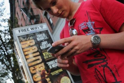 Dutch tourist Bas Derksen surfs the internet at a free Wi-Fi hotspot in Manhattan on July 11, 2012
