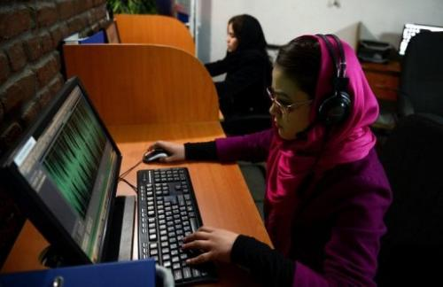 Employees are pictured working at Awaz, the private company that owns Globox.tv, in Kabul on January 30, 2013
