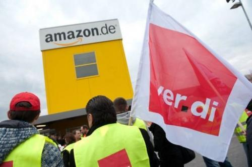 Employees of online retailer Amazon take part in a demonstration in Bad Hersfeld, central Germany, on April 9, 2013