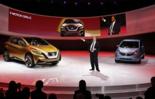 Executive VP of Nissan introduces its concept hybrid-electric car at the Detroit auto show, January 15, 2013, Michigan