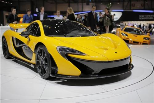Ferrari and  McLaren unveil hybrid supercars