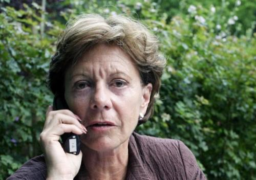 File picture of Neelie Kroes talking on a mobile phone in Wassenaarseslag, Netherlands, on August 3, 2004