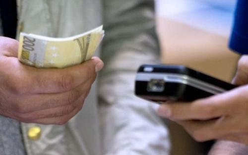 Financial groups are battling to control the lucrative future of 'mobile money', which lets people pay via a smartphone