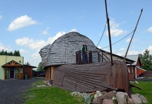Grzegorz Skalmowski outside his office as his snail farm in Krasin, northern Poland, on May 29, 2013