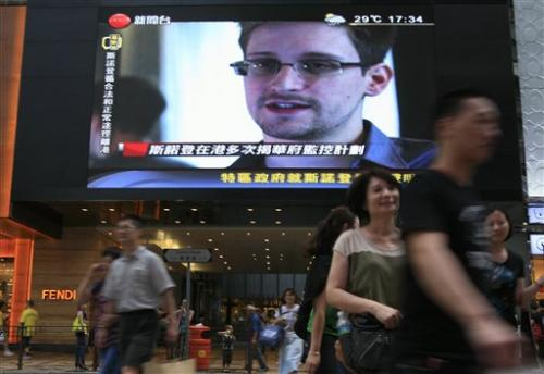 Hong Kong says Snowden has left for third country