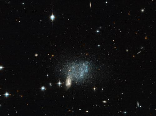 Hubble sees stars fleeing a cosmic crash