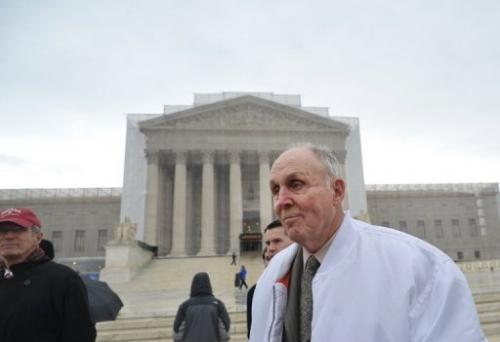 Indiana grain farmer Vernon Hugh Bowman walks past the US Supreme Court on February 19, 2013 in Washington