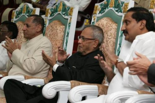 Indian President Pranab Mukherjee and ministers applaud during the rocket launch at Sriharikora on February 25, 2013