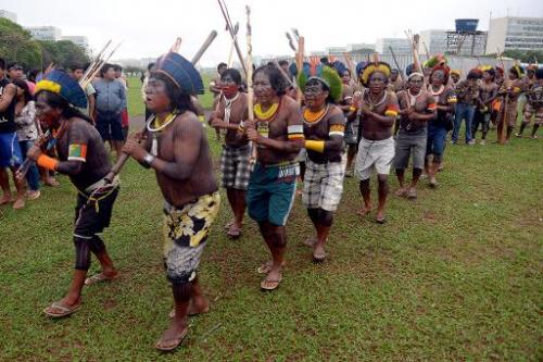 Indigenous Brazilians demonstrate with Greenpeace activists near government buildings in Brasilia on October 1, 2013, to demand