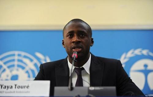 Ivory Coast's football player Yaya Toure speaks during a press conference as he was appointed the United Nations Environment Pro