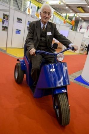 """James Dower sits astride the """"Tilt and Turn"""" at the International Exhibition of Inventions in Geneva on April 10, 2013"""