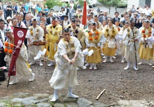 Japanese Buddhist monks mark the official opening of Mount Fuji climbing season at Murayama Sengen Shrine, July 1, 2013