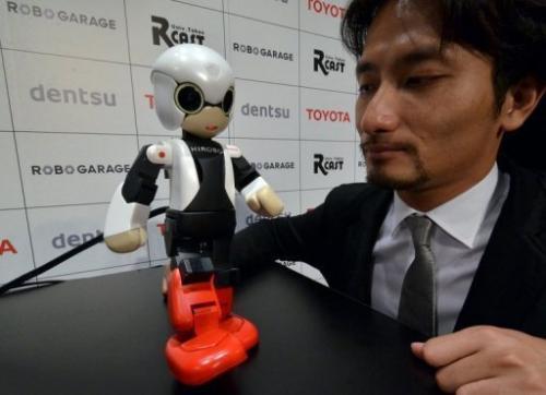 Japan's Tokyo University robot creator Tomotaka Takahashi demonstrates robot Kirobo in Tokyo on June 26, 2013
