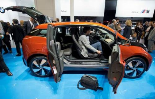 Journalists view BMW's i3 electric car at the Frankfurt Motor Show (IAA) on September 9, 2013